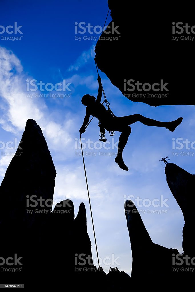 Climber dangling from a rope. royalty-free stock photo