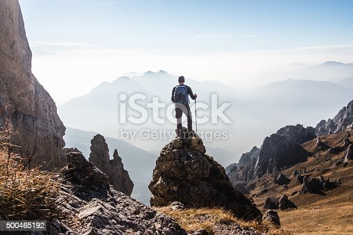 istock Climber enjoys the view from the top of the mountain 500465192