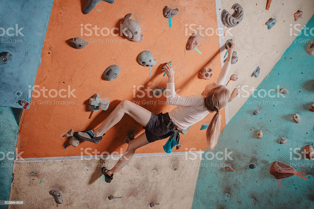 Climber girl training in gym stock photo