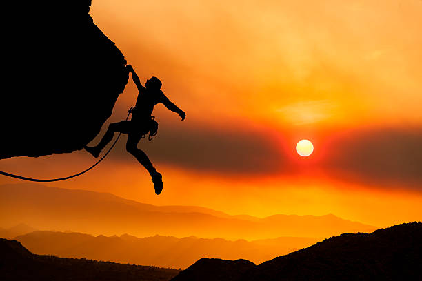 climber grips the edge. - daredevil stock pictures, royalty-free photos & images