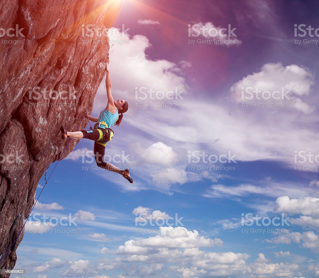 Climber hanging on her hand stock photo