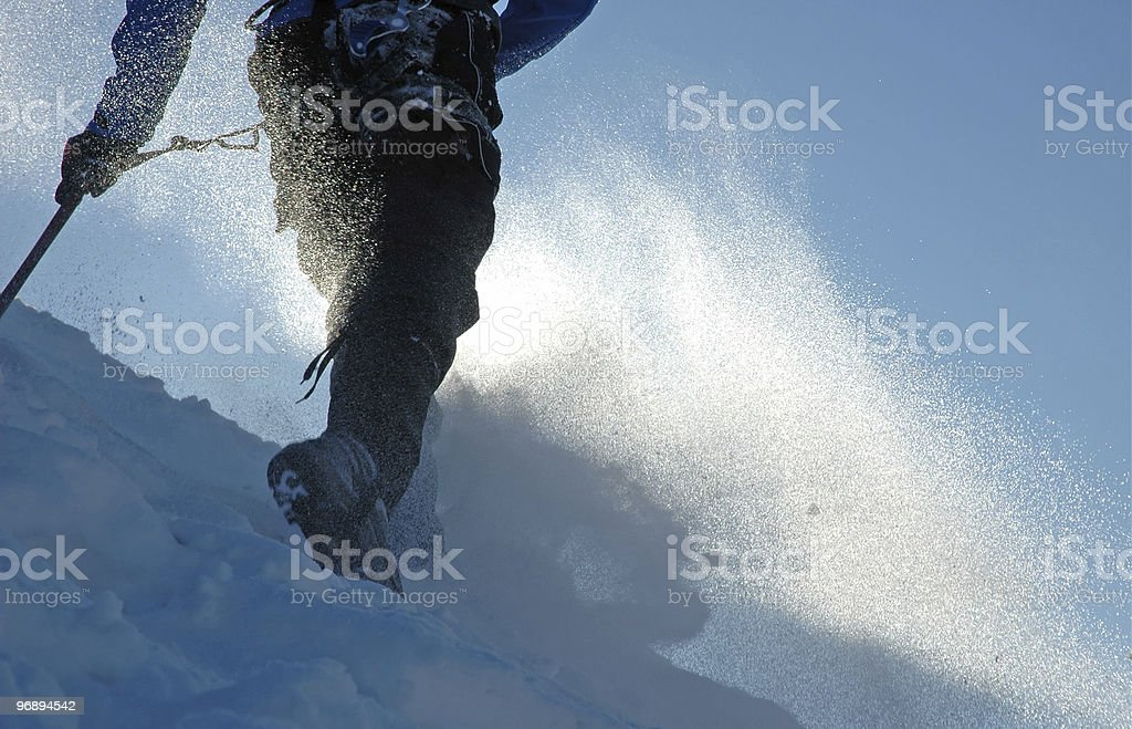 Climber in a snowstorm royalty-free stock photo