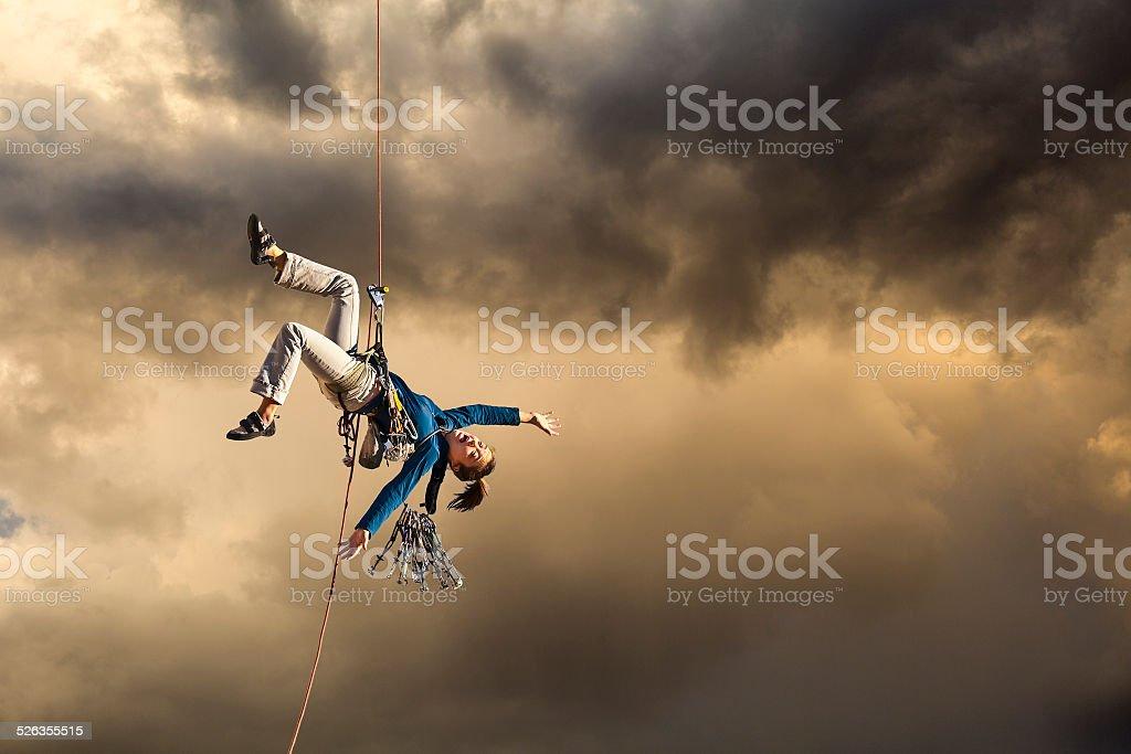 Climber looses her balance. stock photo