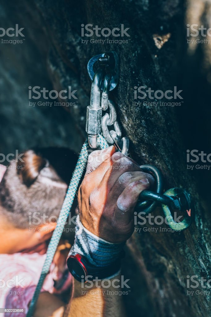 Climber Man Climbing On The Rock, Close-up Of Hand With Tape In Magnesium Powder stock photo