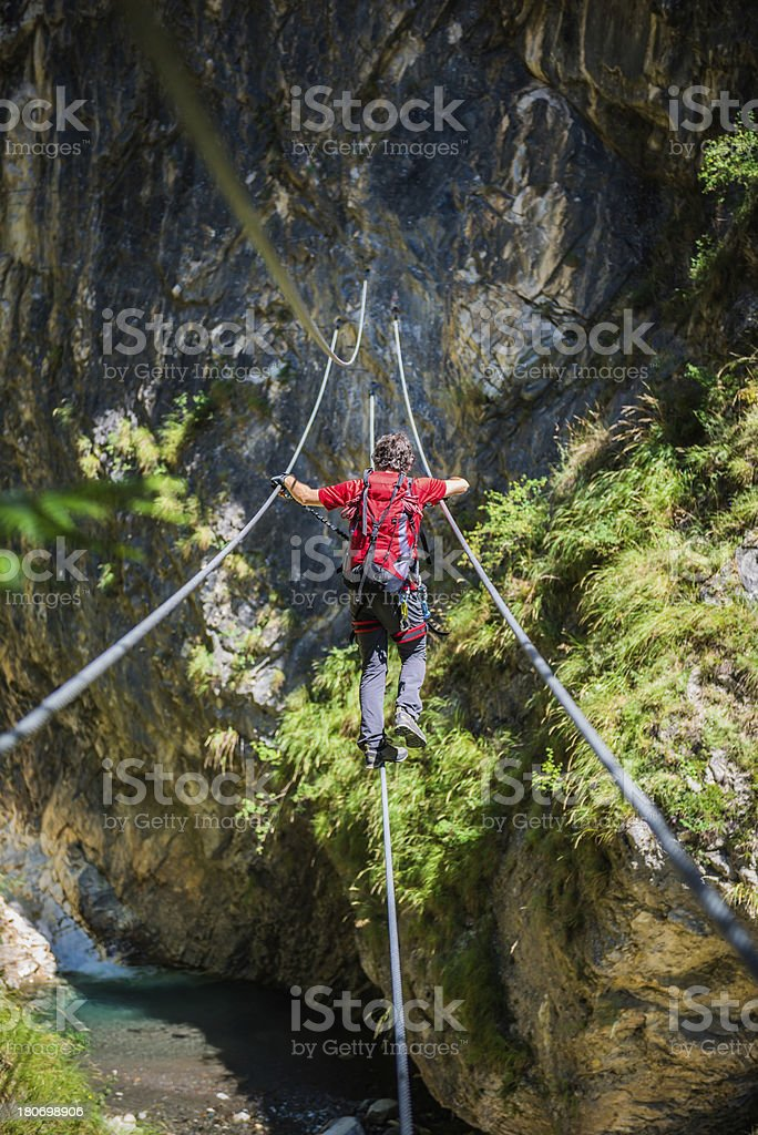Climber on a Rope Bridge stock photo