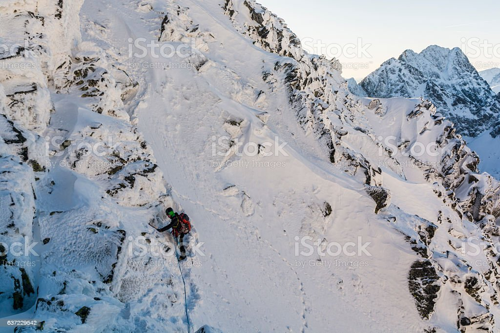 Climber on a steep slope. stock photo