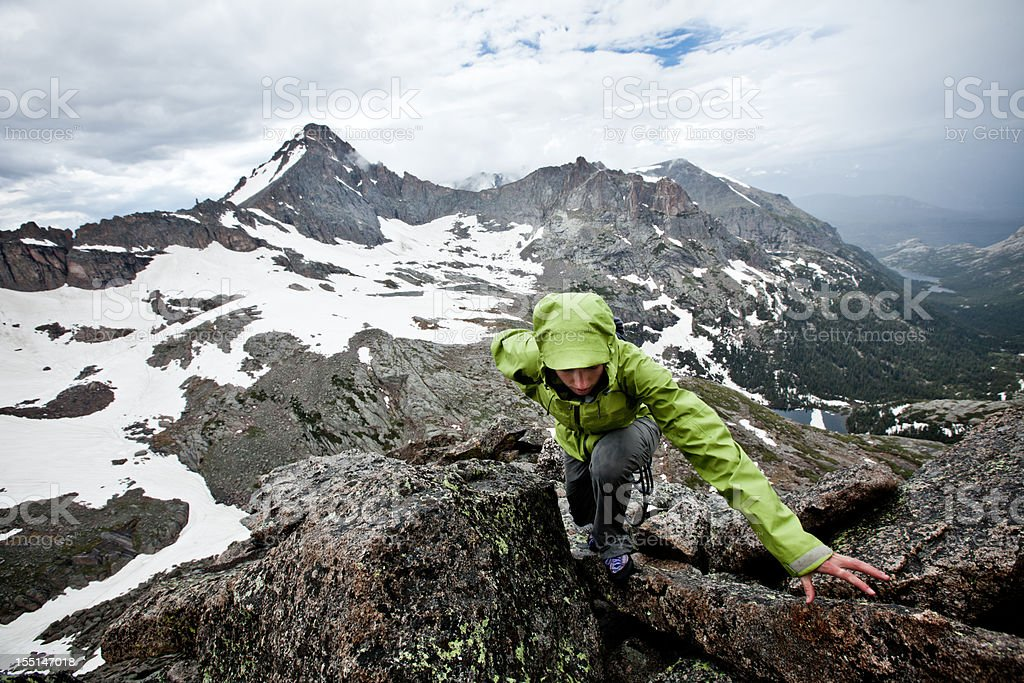 Climber on a Stormy Summit royalty-free stock photo