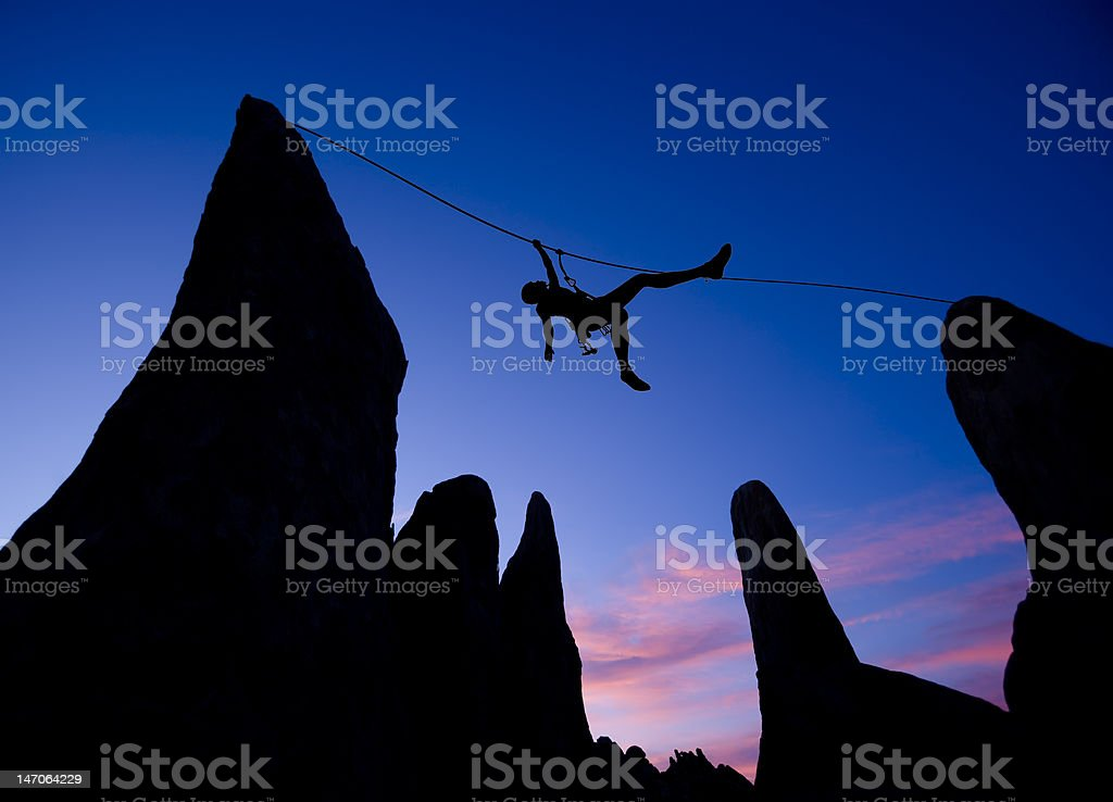 Climber on a tyrolean traverse. stock photo