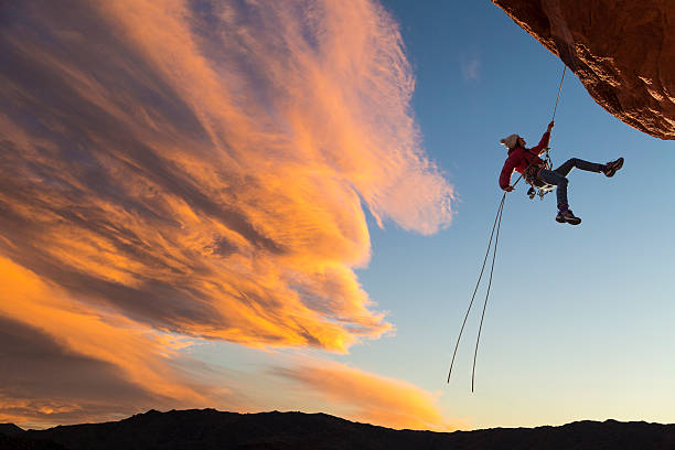 Climber on rappel. stock photo