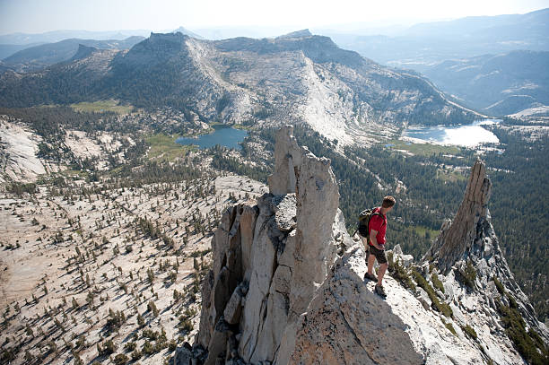 Climber on summit stock photo