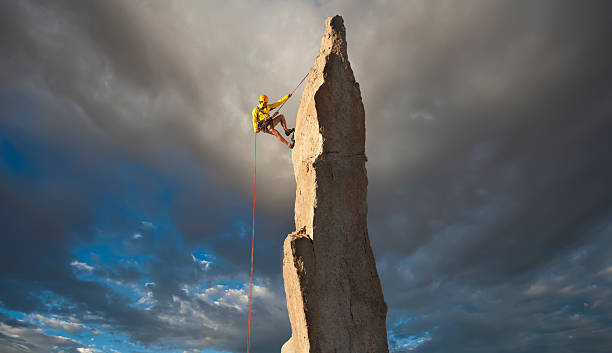 climber on the edge. - daredevil stock pictures, royalty-free photos & images