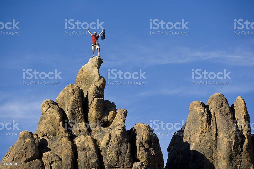 Climber on the summit. stock photo