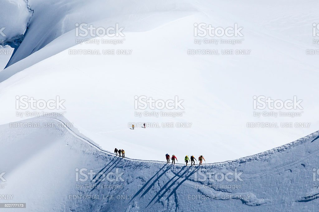 Climber on the way to the top of Mont Blanc. stock photo