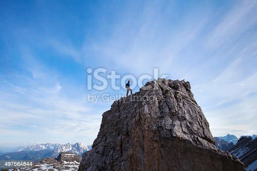 istock climber on top of the mountain 497564844