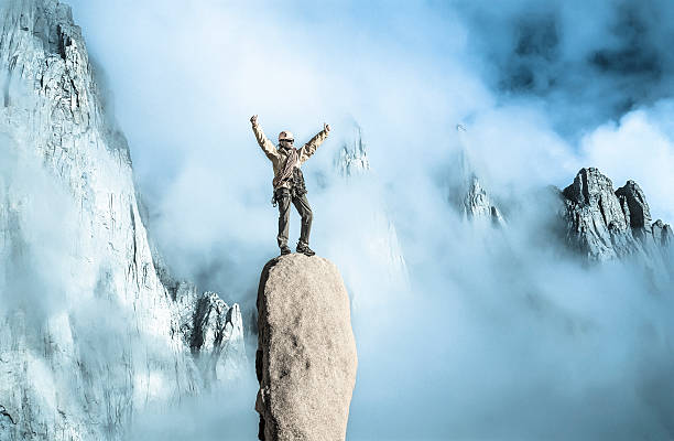 climber on top of the mountain. - daredevil stock pictures, royalty-free photos & images