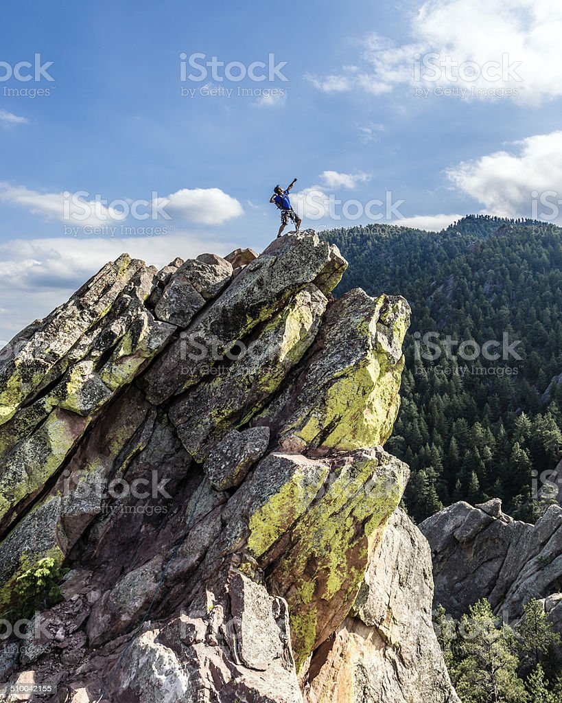 Climber Posing on top of Mountain stock photo