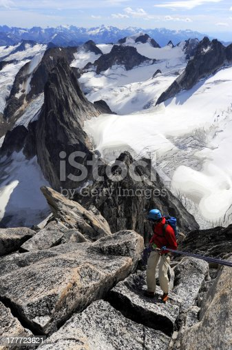 istock Climber rappelling 177723621