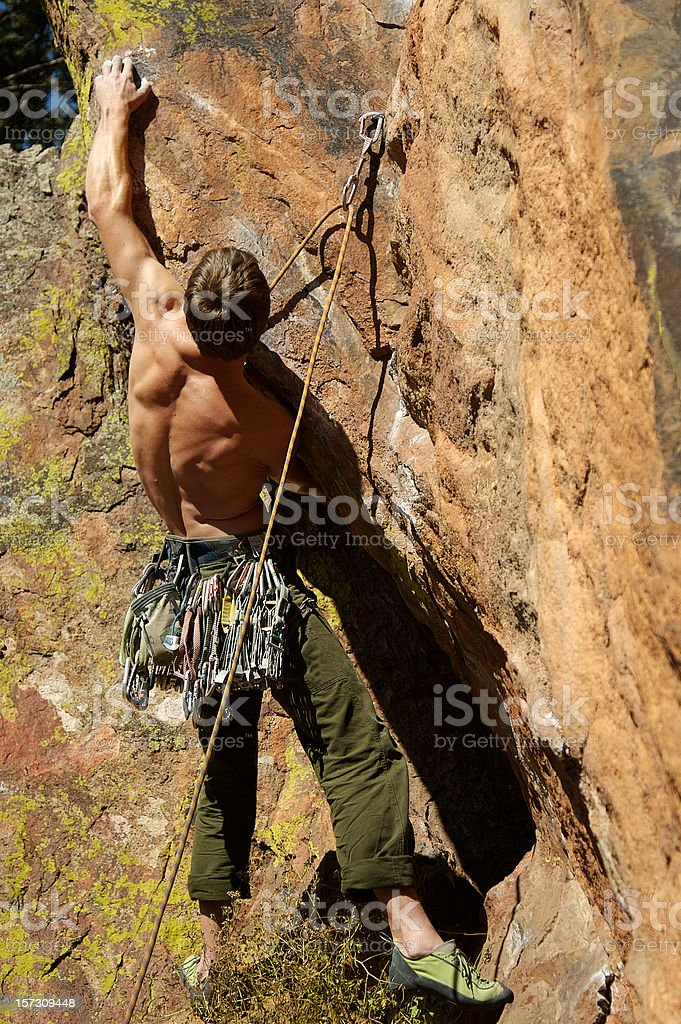 Climber reaches for a hold royalty-free stock photo