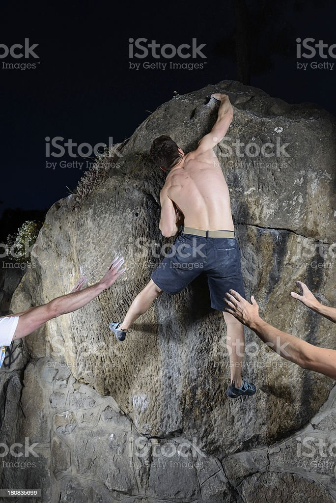 climber resolving a bouldering problem royalty-free stock photo
