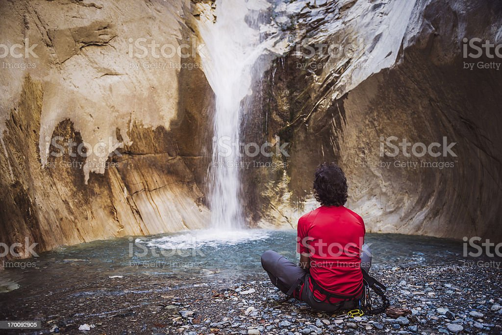 Climber Rest in front of a Waterfall royalty-free stock photo