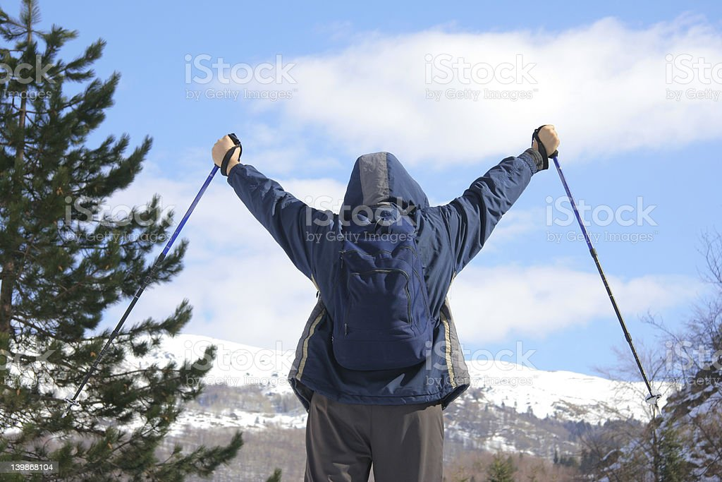 Climber standing on top of a mountain royalty-free stock photo