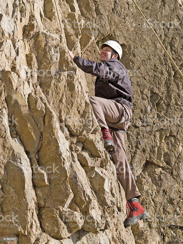 climber swarming up the wall royalty-free stock photo