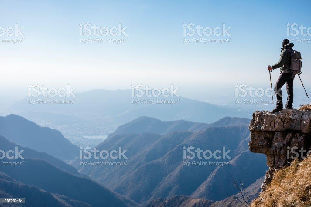 Climber watches a mountain valley stock photo