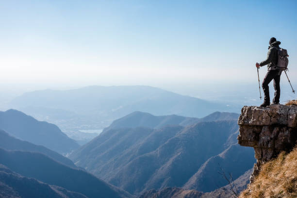 Climber watches a mountain valley stock photo
