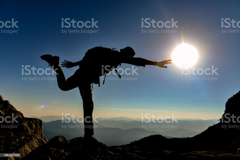 climber who did yoga at the summit stock photo