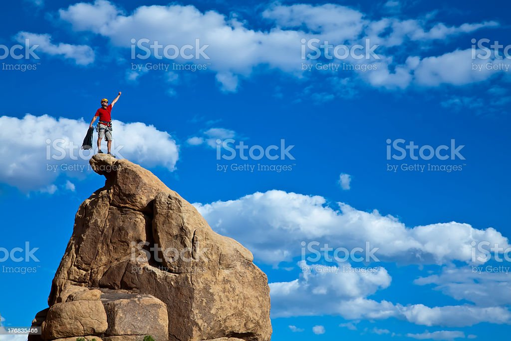 Climber who has reached the summit stock photo