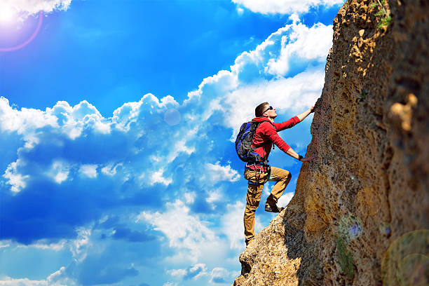 climber with backpack - clambering stock photos and pictures