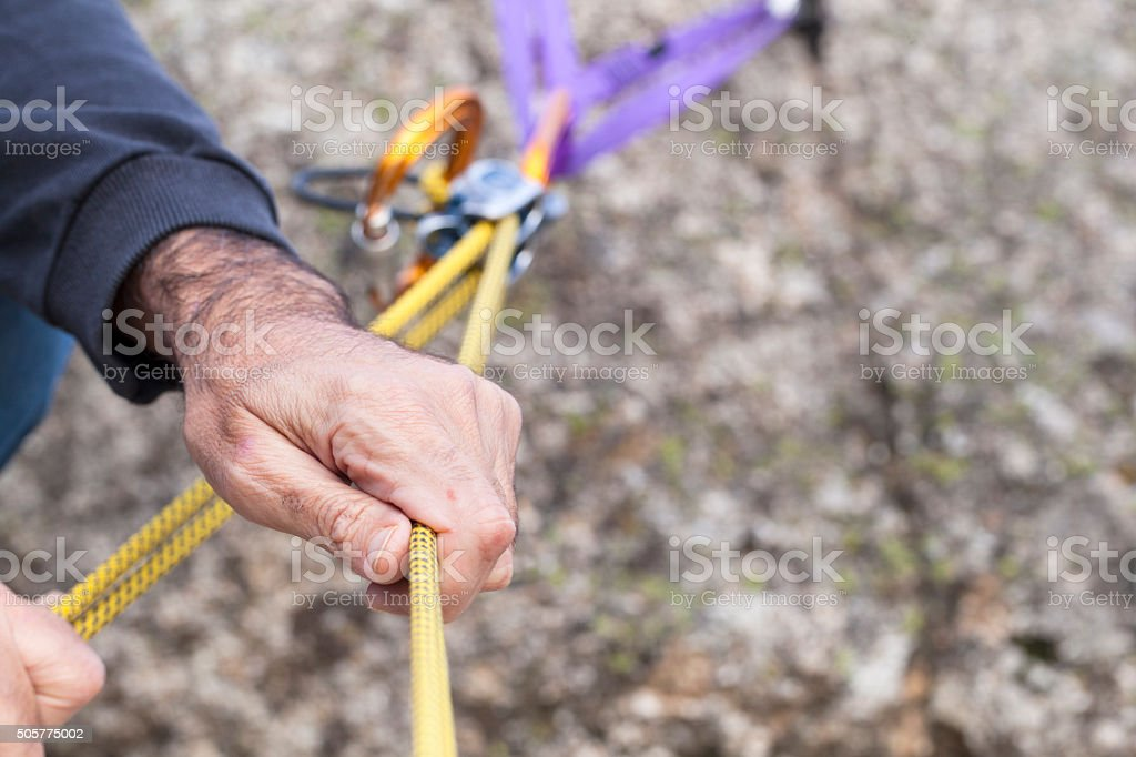 Climber with belay device stock photo