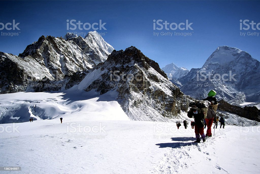 Climbers and sherpas on glacier stock photo