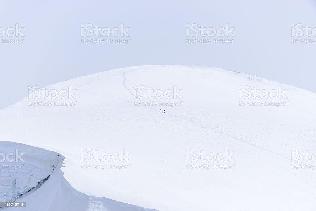 Climbers approaching the mountain summit -XXXL royalty-free stock photo