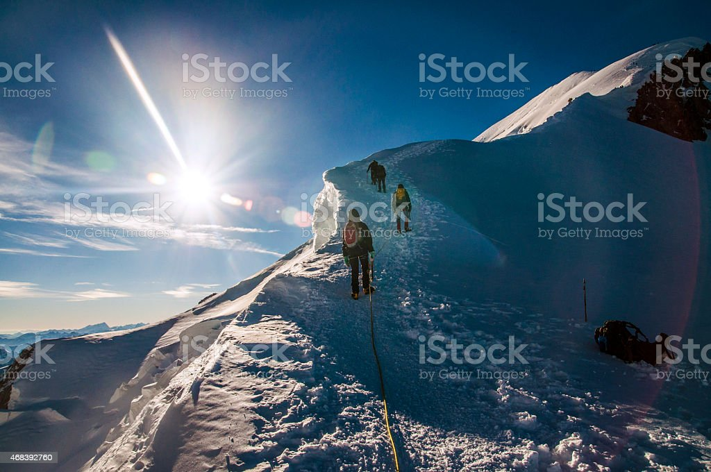 climbers climbing Mont Blanc mountain stock photo