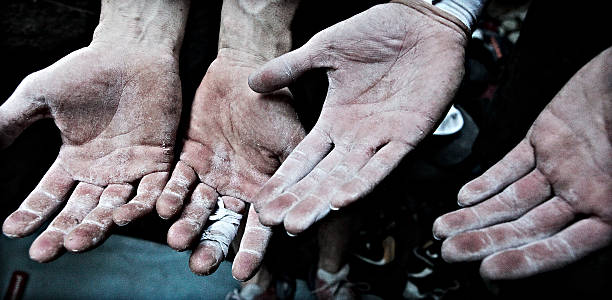 Climber's hands stock photo