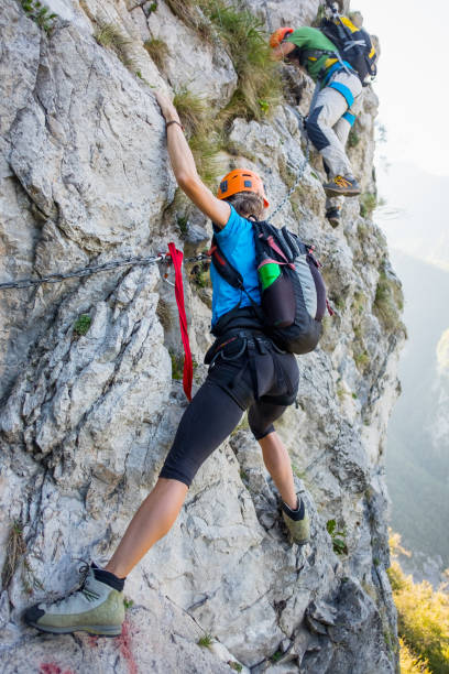 climbers on equipped rockface - clambering stock photos and pictures