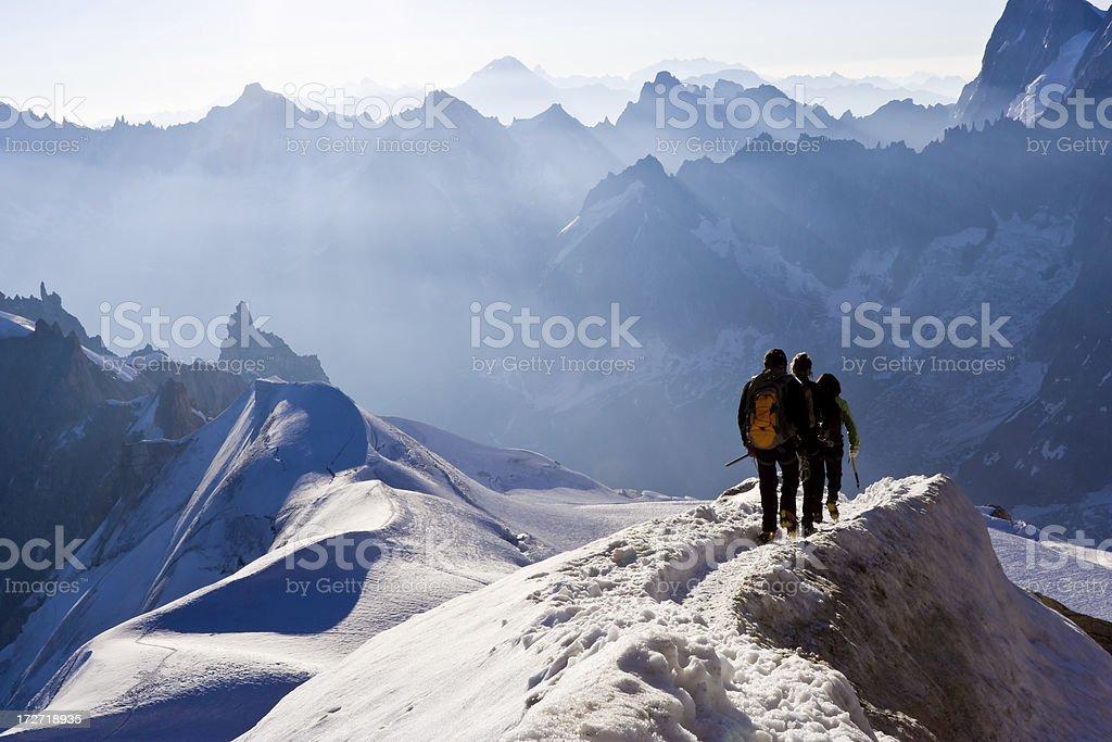 Climbers on mountain ridge royalty-free stock photo