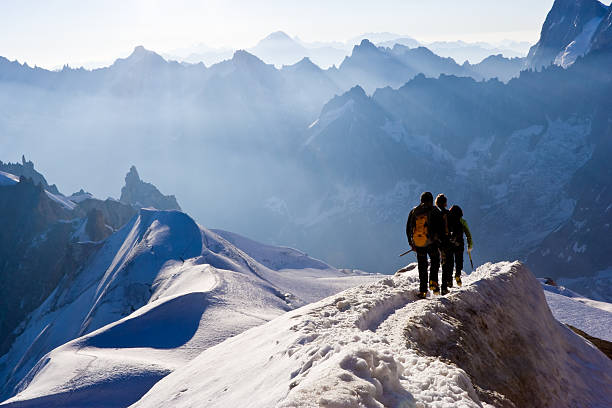 Climbers on mountain ridge stock photo