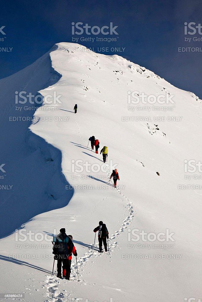 climbers on mountain ridge stock photo