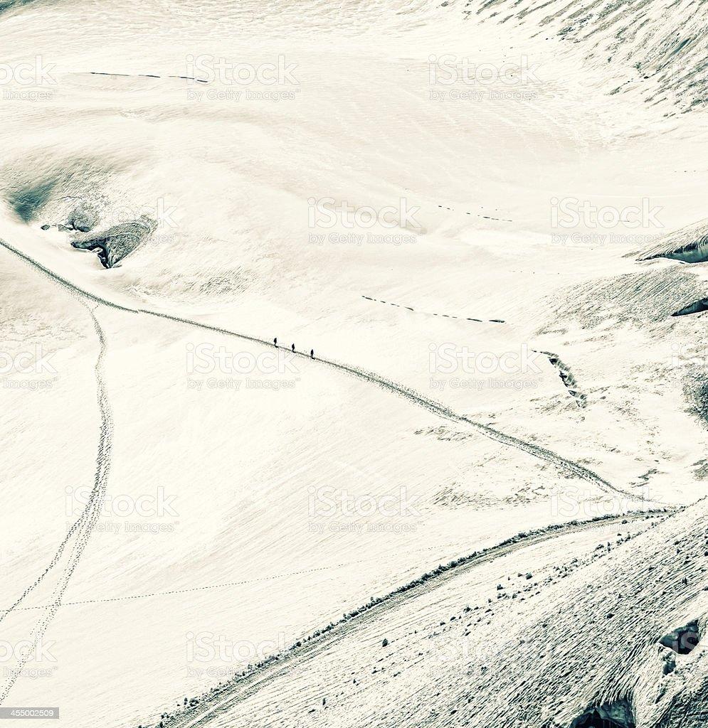 Climbers traversing Aletsch glacier below Jungfrau summit royalty-free stock photo