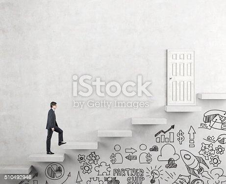 513121118istockphoto Climbing a ladder of success 510492946