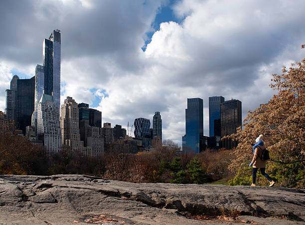 Climbing a rock in Central Park, New York stock photo