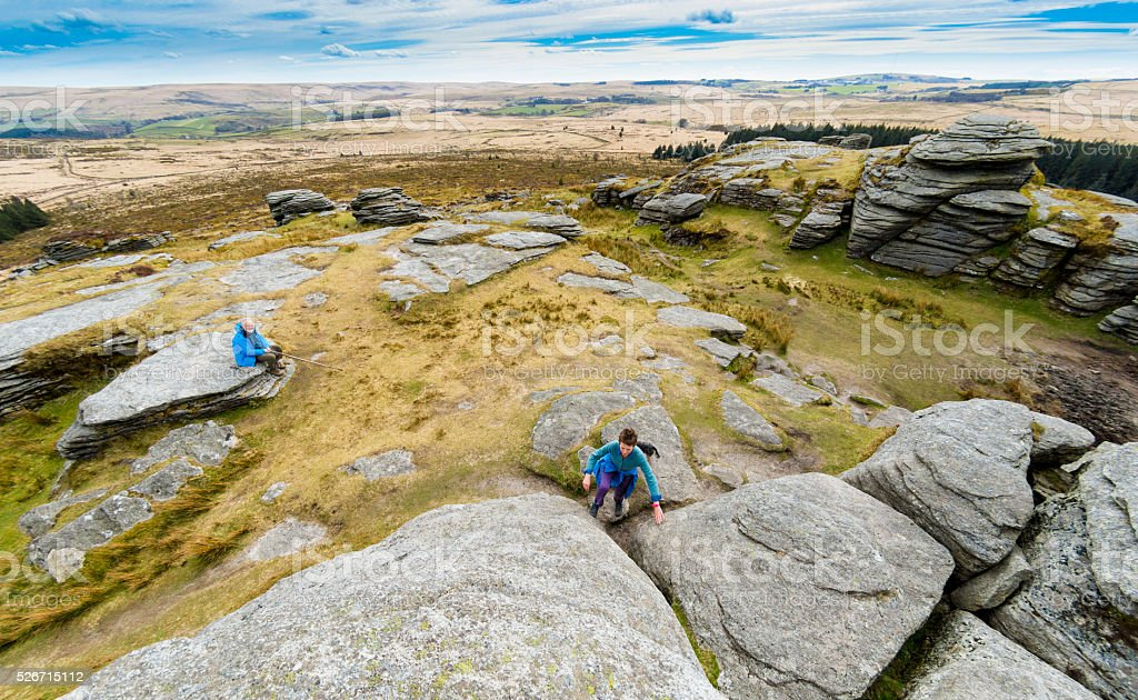 Climbing a Tor on Dartmoor stock photo