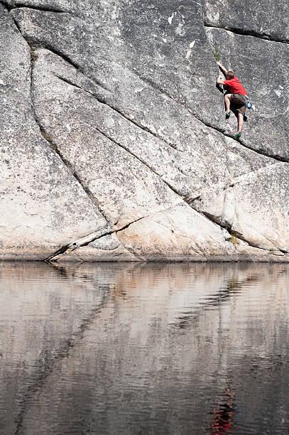 Climbing above water stock photo