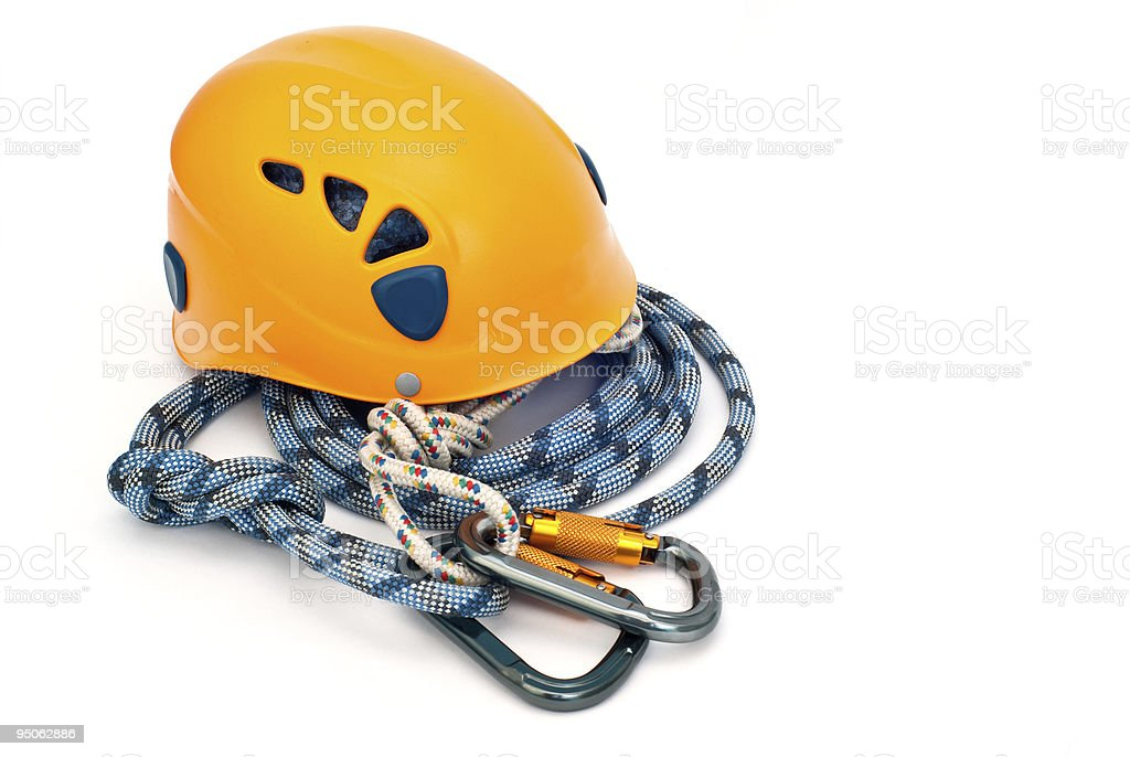 climbing equipment - carabiners, helmet and blue rope stock photo