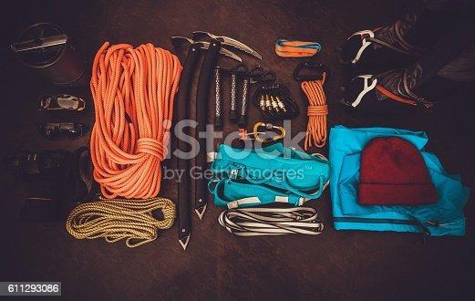 istock Climbing equipment set on dark background Travel lifestyle 611293086