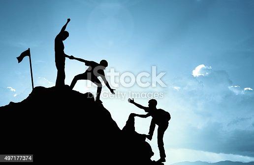 istock climbing helping  team work , success concept 497177374