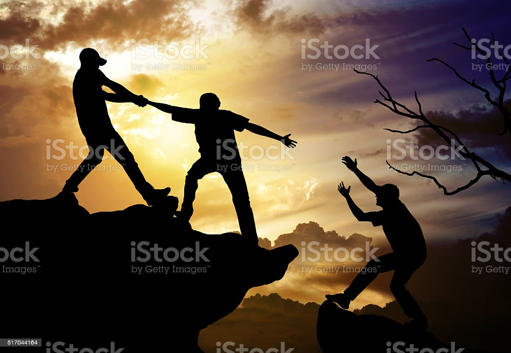 climbing helping team work , success concept stock photo