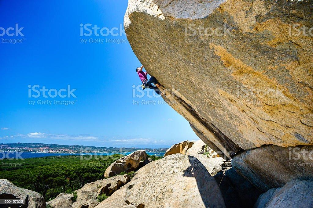 Climbing in Caprera Island stock photo